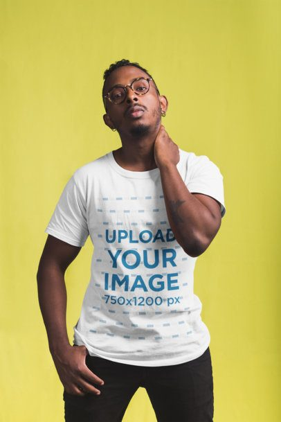 T-Shirt Mockup Featuring a Man Standing at a Photographic Studio 21054