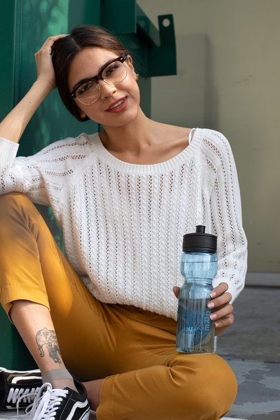 Water Bottle Mockup of a Woman Wearing Cool Retro Glasses 24423