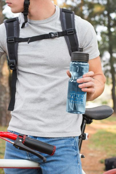 Sports Bottle Mockup Featuring a Man on a Mountain Bike 24427