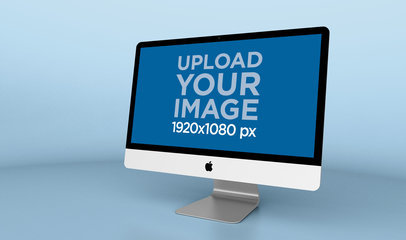 Mockup of an iMac Standing in a Solid Colored Space 24782