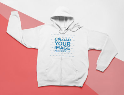 Mockup of a Zip-Up Hoodie Lying on a Flat Tricolor Surface 24569