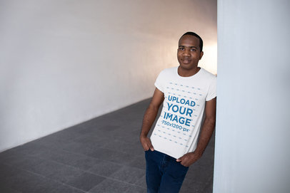 T-Shirt Mockup of a Man Standing in a Hallway 24073
