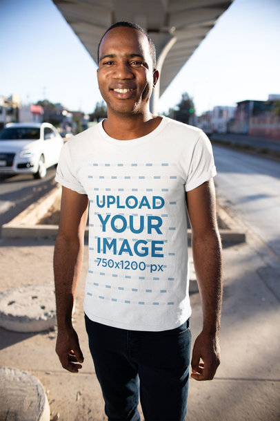 T-Shirt Mockup of a Smiling Man Under a Bridge 24075
