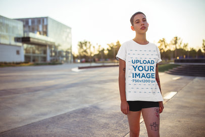 Tee Mockup of a Woman with a Buzz Cut Standing Outside 20187