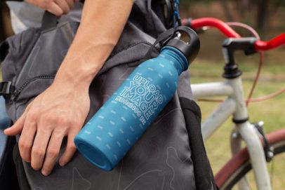 Aluminum Water Bottle Mockup with a Man and His Bicycle 24432