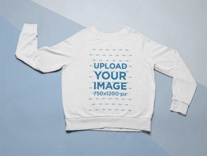 Mockup of a Sweatshirt over Colored Cardboard Paper 24574
