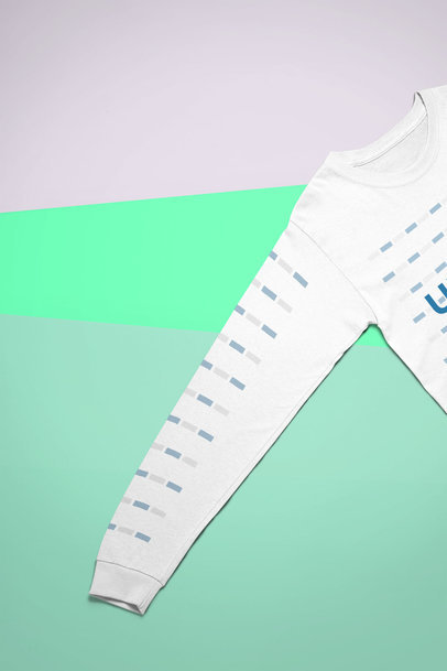 Mockup of a Long Sleeve T-Shirt Laid on a Tricolor Surface 24549