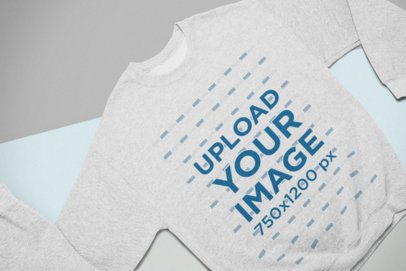 Mockup of a Heathered Crewneck Sweatshirt Lying on Colored Pasteboards 24546