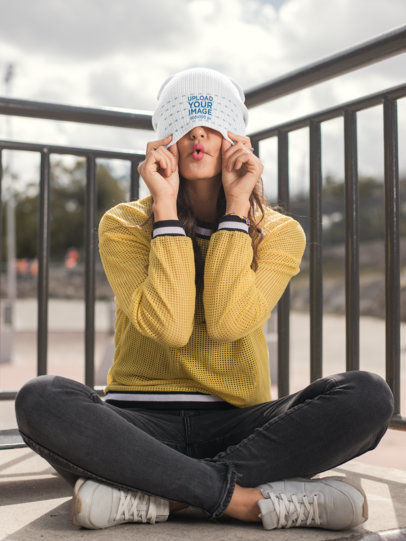 Mockup of a Woman Hiding Her Face with Her Beanie 24611