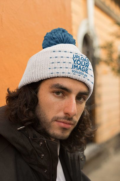 Mockup of a Handsome Man Wearing a Pom Pom Beanie 24594