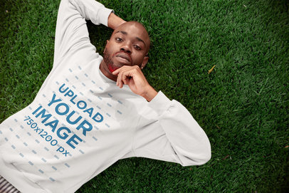 Sweatshirt Mockup of a Man Lying on Grass 21689
