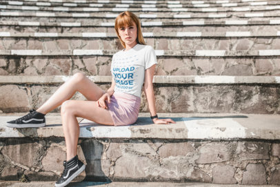 Mockup of a Beautiful Strawberry Blonde Haired Girl Sitting on Stone Steps 20130