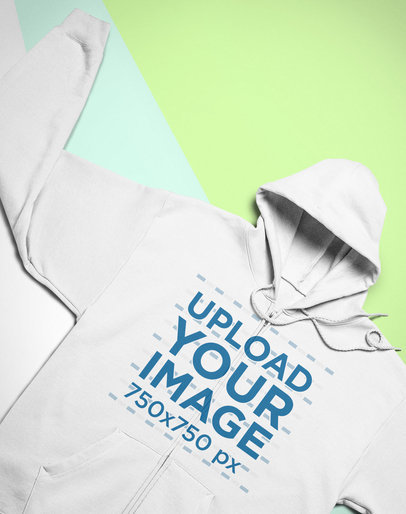 Mockup of a Full-Zip Hoodie Lying Flat over a Custom Surface 24539