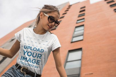 Mockup of a Young Woman Wearing a T-Shirt in a City 24641