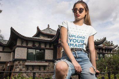 Mockup of a Cool Woman Wearing a Tee in Front of an Oriental House 24645