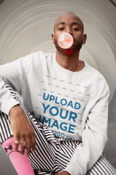 Mockup of a Trendy Man Wearing a Sweatshirt and Blowing Bubble Gum 21687