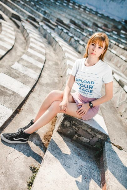 Tshirt Mockup Featuring a Girl with a Street Style Outfit Sitting on Stone Steps  20128