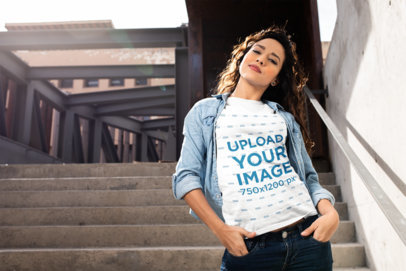 Mockup of a Woman with Curly Hair Wearing a Tee 24652