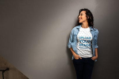 Mockup of a Woman Casually Leaning on a Wall Wearing a T-Shirt 24653