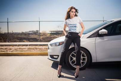 T-Shirt Mockup of a Stylish Woman in Office Outfit Leaning Against a Car 20063