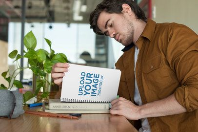 Notebook Mockup Featuring a Young Man Studying 24155