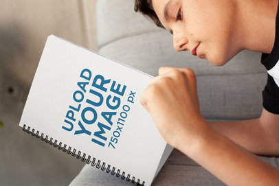 Mockup of a Boy Reading His Notebook 24139