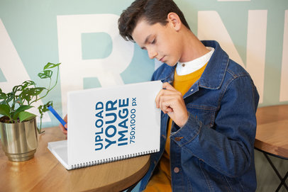Mockup of a Boy Reading from His School Notebook 24134