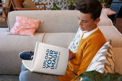 School Notebook Mockup Featuring a Young Boy Sitting Comfortably on a Couch 24131