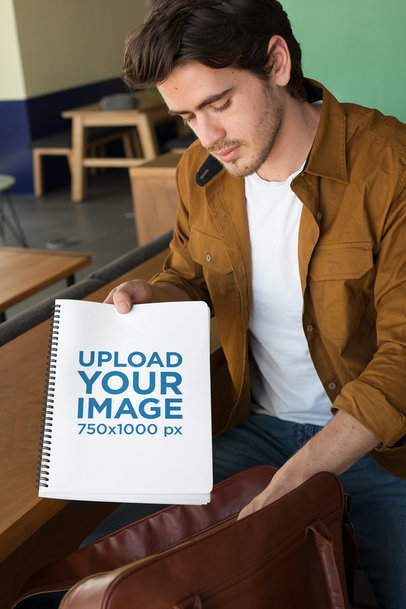 Mockup of a Man Taking a Notebook from His Bag 24159