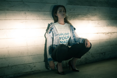 Tee Mockup of a Woman Crouching in Front of Car Headlights 20067