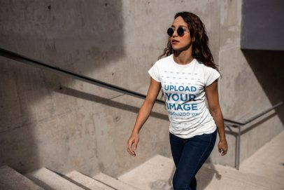 Mockup of a Woman Walking Up Stone Steps Wearing a T-Shirt  24658