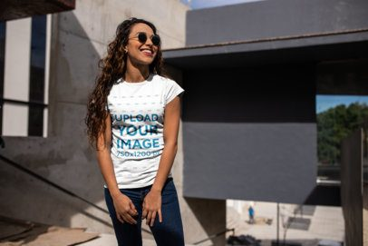 Urban Mockup of a Smiling Girl with Long Curly Hair Wearing a Tshirt 24657