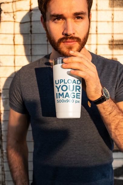 Travel Mug Mockup of a Man Facing the Sun 24400