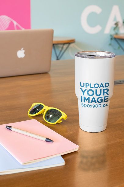 Mockup of a Tumbler Standing on a Wooden Desk 24446