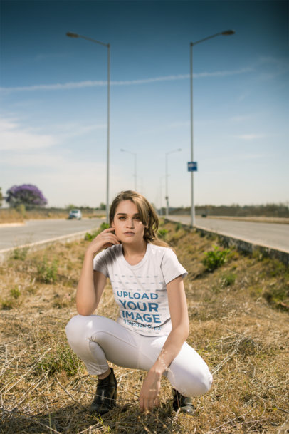 T-Shirt Mockup of a Woman in a Crouching Pose Outdoors 20081