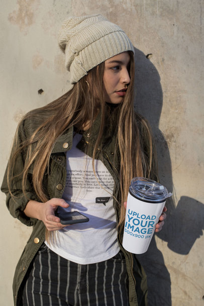 Mockup of a Beautiful Girl Holding a Travel Mug 24338