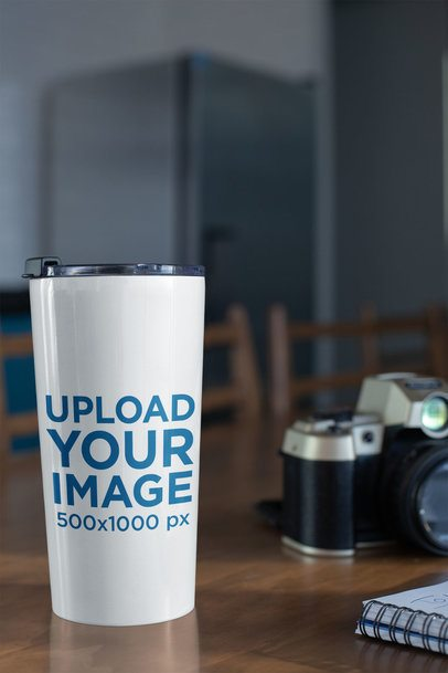 Mockup of a Travel Mug on a Wooden Table 24450