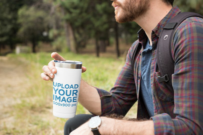 Travel Mug Mockup Featuring a Man Sitting Outdoors 24388