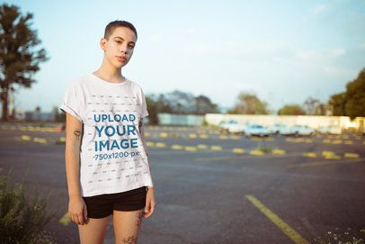 Mockup of a Pretty Girl with a Pixie Cut Wearing a Tee in a Parking Lot 20189