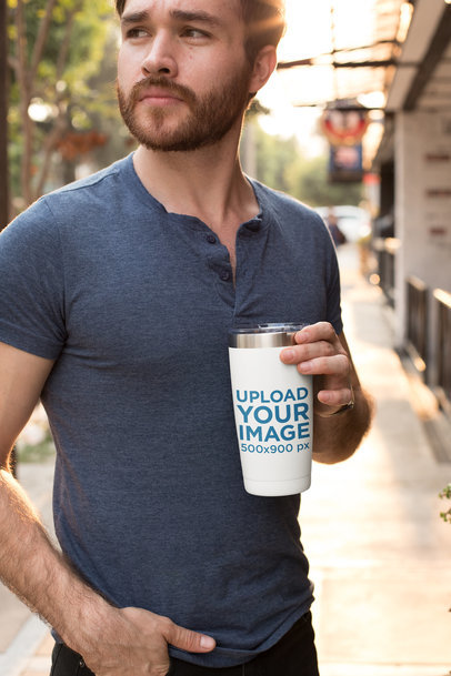 Mockup of a Man Holding His Travel Mug Outside 24398