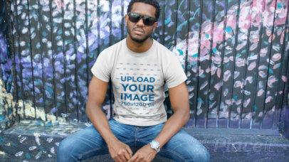 T-Shirt Mockup Video of a Man Sitting on a Bench 12116