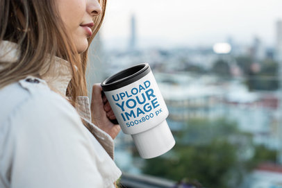 Mockup of a Woman Holding a Travel Mug Outside 24346