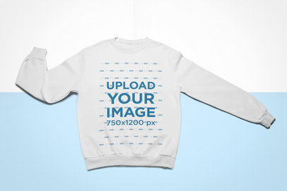 Mockup of a Crewneck Sweatshirt Lying Flat on a Colored Surface 24759