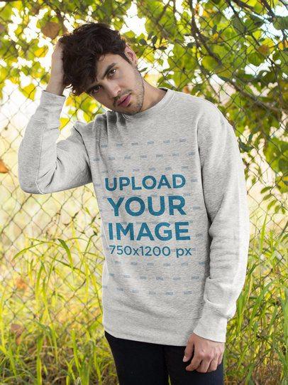 Sweatshirt Mockup of a Good Looking Man Outside 18183
