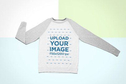 Mockup of a Long Sleeve Raglan Tee over a Colorful Background 24761