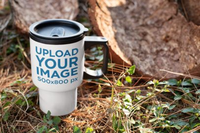 Mockup of a Travel Mug Standing in a Wooden Area 24383