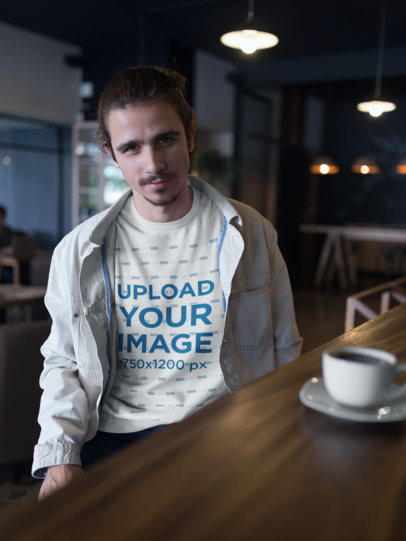 Sweatshirt Mockup of a Smiling Man at a Cafe 18103