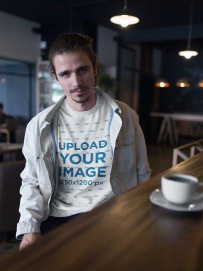 Sweatshirt Mockup of a Smiling Man at a Cafe 18103