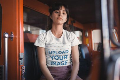 Tee Mockup of a Woman Sitting in a Red Fire Truck 19620