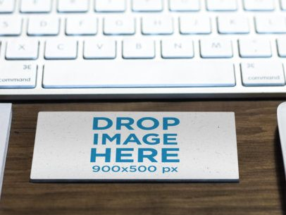 Mockup of a Business Card in Landscape Position on Top of a Desk a6134